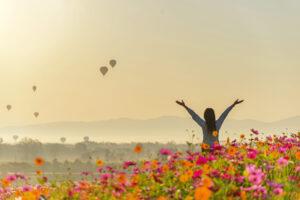 Happy woman in field of flowers