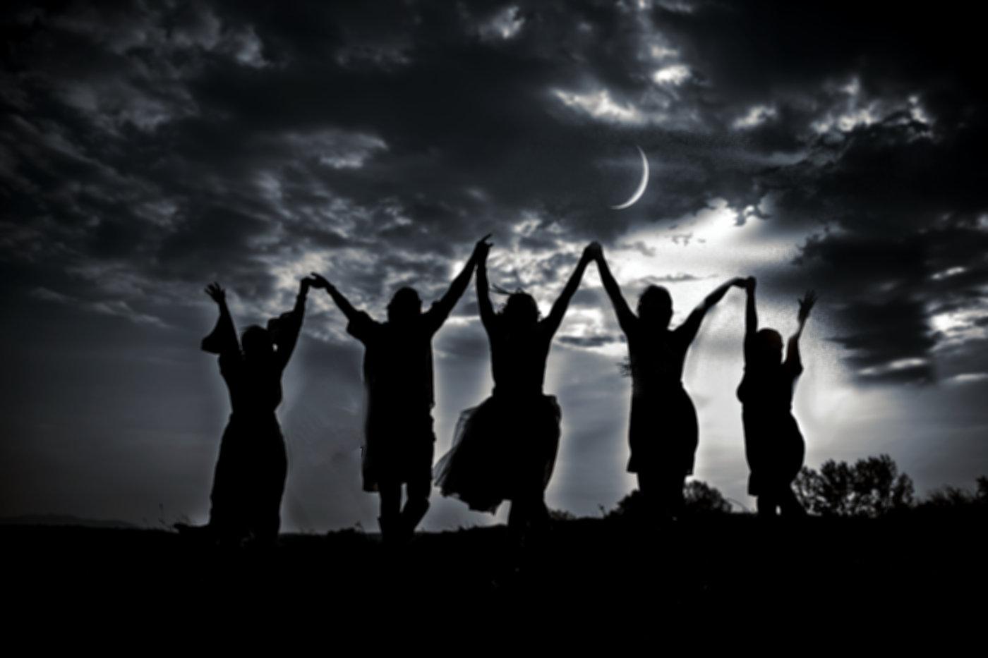 Woman dancing under moon