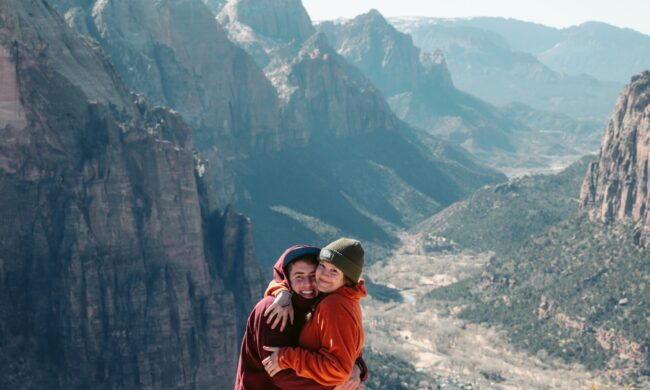 Aries new moon Couple hugging on a mountaintop