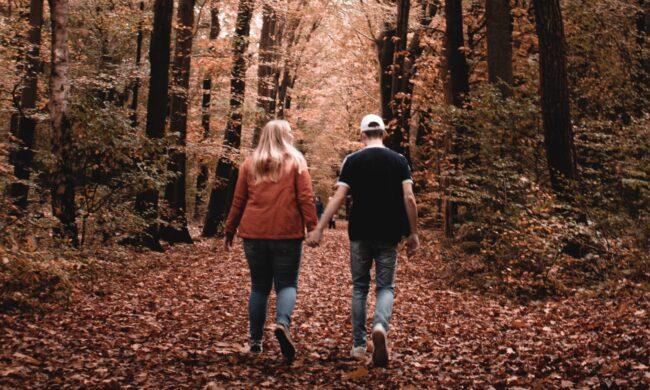 couple walking in Fall woods